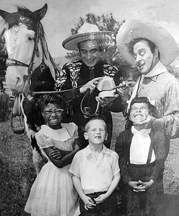 The Cisco Kid (Duncan Renaldo) and Pancho (Leo Carrillo) clown around with a  group of young fans.
