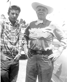 Hoot Gibson poses with a young fairgrounds worker in ??