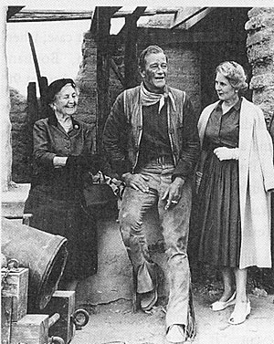 "While filming ""The Alamo"" John Wayne met with ladies from the Daughters of the Republic of Texas. At the time, the 120 year old group had run The Alamo since 1905."