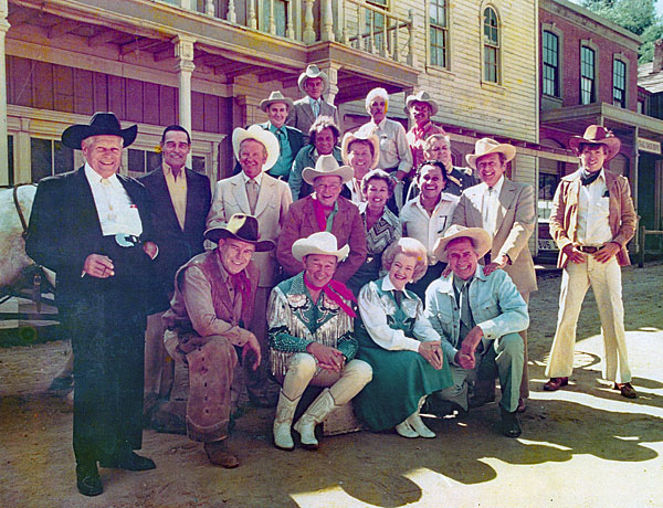 A great gathering of guns...(top row L-R) Pat Buttram, Guy Madison, John Hart, John Pickard. (second row L-R) Andy Devine, John Russell, Rex Allen, Don Barry, unknown above Barry, John Smith, Peggy Stewart, Pedro Gonzales Gonzales, Rand Brooks, Will Hutchins. (kneeling L-R) unknown, Roy Rogers, Dale Evans, Jock Mahoney.