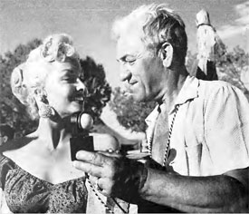 "Director of Photography Walter Strenge checks lighting on Mari Blanchard for a  scene in ""Stagecoach to Fury"" ('56 Fox)."