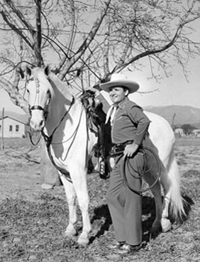 Two great photos of Whip Wilson with his horse Rocket.