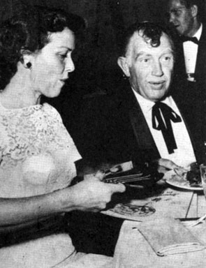 "Andy Devine and wife Dodie ""jingle"" at the premiere party for ""Arond the World in 80 Days""."
