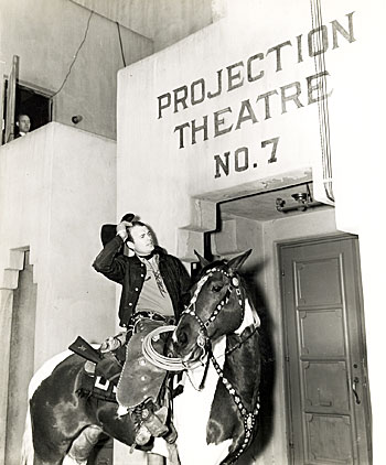 "Bob Baker rides up on Apache to a Universal studio projection room to view his latest, ""Border Wolves"" ('38). (Thanx to Neil Summers.)"