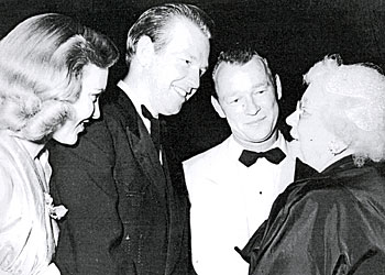 Rex Allen and his wife are introduced to Ida Koverma by Roy Rogers at a dinner to honor Adolph Zukor. Koverma came to give thanks to the Western stars for appearing at many of her benefits.