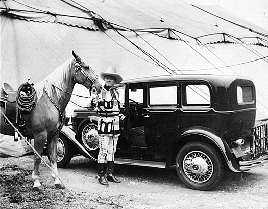 Tom Mix with his palomino Comanche pose next to Tom's Nash at the Sells-Floto Circus in 1930. Tom toured with the circus from 1929 to 1931 at a reported salary of $20,000 a week. Although Tony was the horse most associated with Tom he often used Comanche for parades and personal appearances. (Thanx to Roy Bonario.)