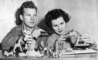 "Bill (""Kit Carson"") Williams and wife Barbara Hale create their own Yuletide gifts. Bill carves minature animals and Barbara adds the paint job. (Photo circa 1949.)"