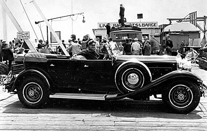 Jack Holt sits in a mighty fine automobile in 1931.