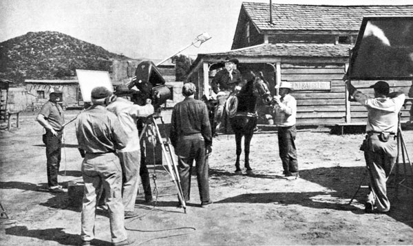 "Setting up a scene for Johnny Carpenter's ""Outlaw Treasure"" ('55 American Releasing)."