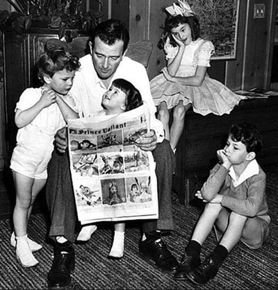 John Wayne reads the December 20, 1942 Sunday comics to his children...Michael, Mary Antonia (Toni), Patrick and Melinda.