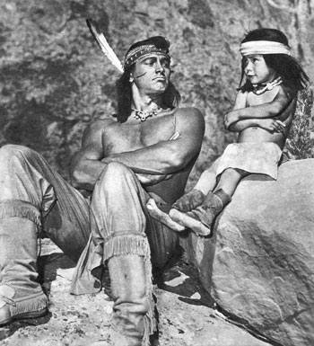 "Rock Hudson spent a lot of time between takes while filming ""Taza, Son of Cochise"" by playing with three year old Jimmy Yellow, youngest of 100 Navajo Indians who worked on the film. Neither could speak the other's language but they got on splendidly together just the same."