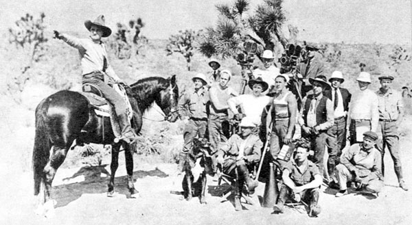 Rare production shot from a silent Tom Mix western. Note the brawny assistant cameraman attired in the striped undershirt who later became a western star himself...George O'Brien.