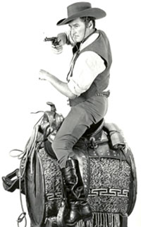 "Errol Flynn prepares for one of those phony riding shots in ""San Antonio"" ('45 WB)."