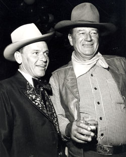 Frank Sinatra and John Wayne attend a SHARE party fundraiser in Beverly Hills.