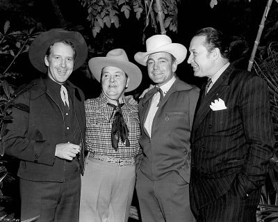 "Dick Foran, producer Henry McCrae, Buck Jones and Monte Blue take a break from filming ""Riders of Death Valley"" serial ('41 Universal). (Thanx to Bobby Copeland.)"
