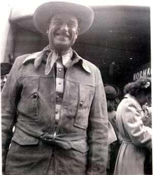 "Ray Whitley outside the Normandie Theatre in New York City on September 28, 1947. Whitley had come to talk to Gene Autry before the showing of ""The Last Roundup"". Whitley was working with Gene's Melody Ranch Madison Square Garden Rodeo. (Photo by Lillian Spencer."