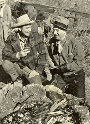"Russell Hayden and producer Harry ""Pop"" Sherman take a little time off while filming ""Heritage of the Desert"" in Kernville, CA, in January 1939, to cook up some Mexican tortillas over an open pit fire."