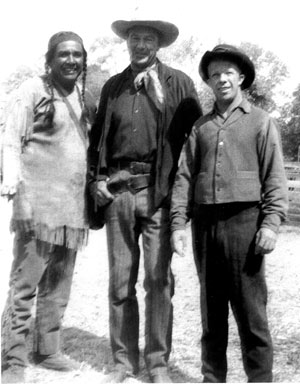 Bit player Tony Urchel and stuntman Whitey Hughes pose with Gary Cooper.