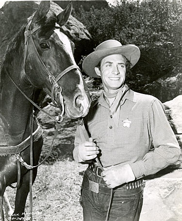 "Jock Mahoney in Charles Starrett's ""Hawk of Wild River"" ('52 Columbia)."