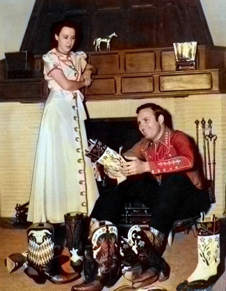 Gene Autry and wife Ina ponder over which pair of boots Gene should wear  to dinner tonight. Photo taken in 1939.