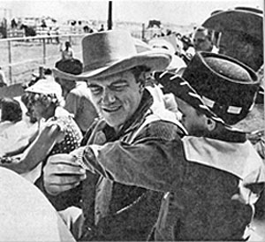 "James Arness and a ""Gunsmoke"" admirer at a 1957 rodeo appearance."