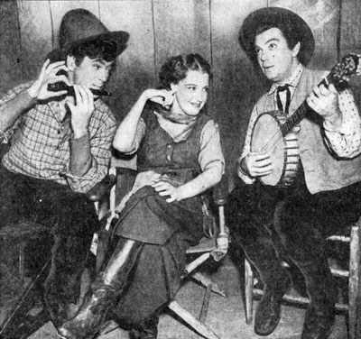 "While filming ""Girl of the Golden West"" in 1938 star Jeanette MacDonald is serenaded by flutist Buddy Ebsen and banjoist Cliff Edwards. Jeanette doesn't seem particularly impressed with the music."