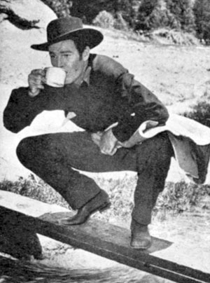 "Rod Cameron takes a break from filming ""Frontier Gal"" ('45 Universal)."