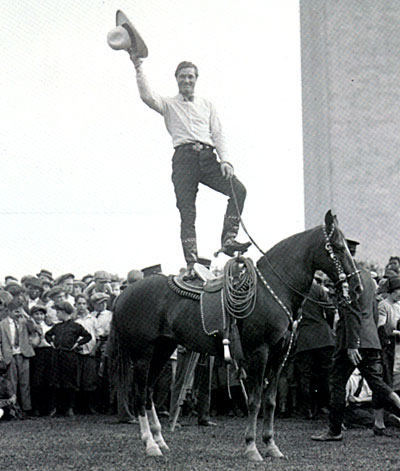 Tom Mix entertains a group of boys with a stunt on Tony on May 21, 1925.  (Thanx to Greg Parrish.)