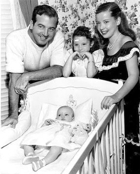 """Restless Gun""—John Payne with wife Gloria DeHaven, daughter Julie Ann  and baby Kathleen in 1946."