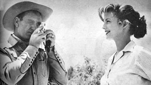 """Annie Oakley"", ""Gene Autry Show""—Gail Davis smiles sweetly for Gene Autry's  Instamatic camera."