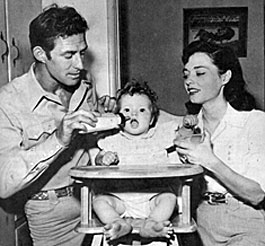"""Range Rider"", ""Yancy Derringer""—Jock Mahoney and wife/actress Margaret Field feed daughter Princess."