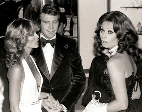 """The Big Valley""—Lee Majors glances at wife/actress Farrah Fawcett...but what is Sophia Loren looking at?"