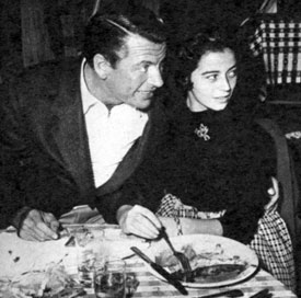 """Empire""—Richard Egan at Guy Madison's birthday party in 1954 dines with Italian engenue Marisa Pavan, Pier Angeli's twin sister."