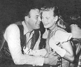 """Shotgun Slade""—Scott Brady at Guy Madison's birthday party in 1954 snuggles up to beer heiress Beverly Pabst."
