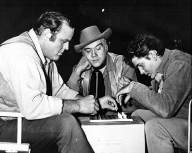 Lorne Greene carefully observes the mental struggle between Dan Blocker and Michael Landon.