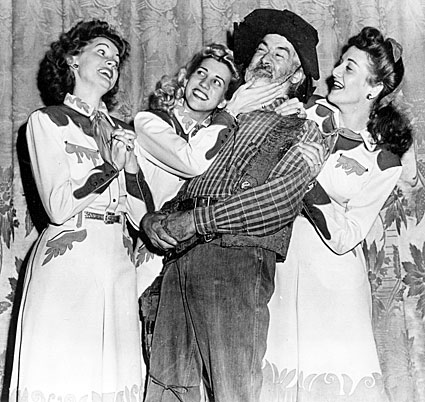 "The Andrews Sisters and Gabby Hayes on the Orpheum stage for  ""The Andrews Sisters"" radio show."