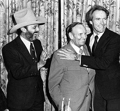"Los Angeles Angels owner Gene Autry with Viva Records co-owners Snuff Garrett and Clint Eastwood at a cocktail reception in L.A. on Dec. 1, 1982 to mark the debut of the soundtrack album for Eastwood's feature film ""Honky Tonk Man""."