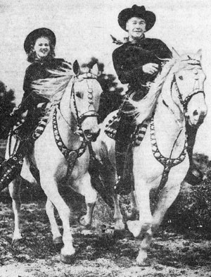 "Grace Bradley and husband Bill ""Hopalong Cassidy"" Boyd take their splendid  Arabian steeds out for a ride."