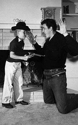 James Arness' son Craig gets the drop on Marshal Dillon.
