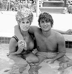 Michael Landon in the pool with Monique Mattson. Who?