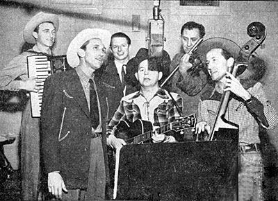 Andy Parker and the Plainsmen. (L-R) George Bamby, Andy Parker, Freddy Haynes, Charley Morgan, Harry Sims and Clem Smith at a Capitol recording session in 1950. Andy and the Plainsmen co-starred in several Jimmy Wakely Monogram Bs.
