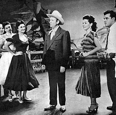 "Rehearsing for Gene Autry's appearance on a ""Godfrey and Friends"" telecast in 1953 are (L-R) Frank Parker, one of the McGuire sisters, Marion Marlowe, Gene Autry, Janette Davis and Julius LaRosa."