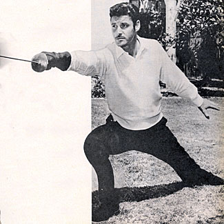 "Guy Williams practices his swordsmanship for his role as ""Zorro""."