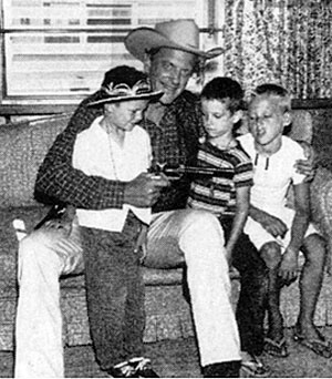 James Arness plays Marshal Dillon with three young boys.