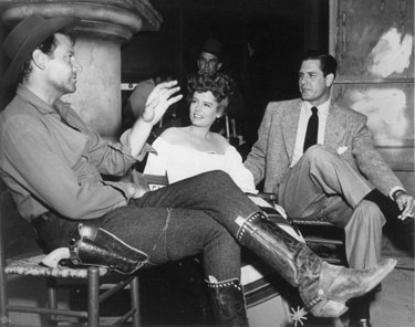 "Informal discussion on the set of ""South of St. Louis"" with Joel McCrea, Alexis Smith and Smith's actor/husband Craig Stevens. ('49)"