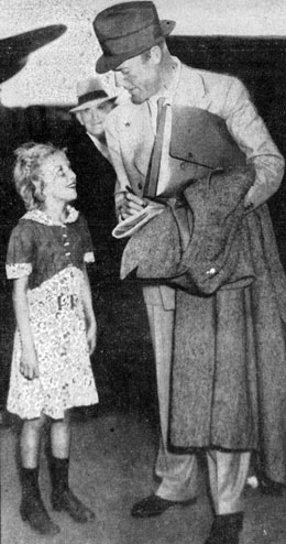 Eleven year old Jean McKelvy of Bowling Green, OH gets an autograph from Randolph Scott at the Washington D.C. airport on October 1, 1937.