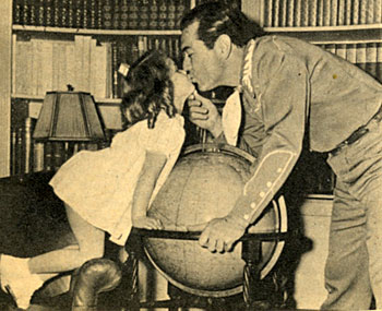 Four and half year old Cynthia gives daddy Johnny Mack Brown a loving kiss.