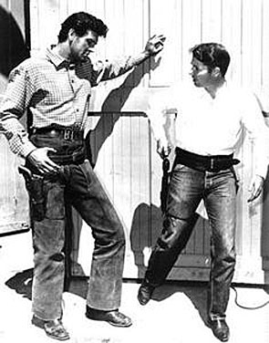 "Audie Murphy teaches Rock Hudson the finer points of gun handling on the set of Universal's ""The Lawless Breed"" in which Hudson played John Wesley Hardin."