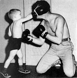 Roy Rogers teaches son Dusty the art of fisticuffs.