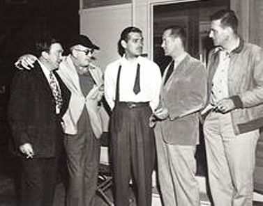 "(L-R) Thomas Mitchell, John Ford, Clark Gable, Robert Montgomery and John Wayne have a chat while Ford, Montgomery and Wayne were all making ""They Were Expendable"" in 1945."